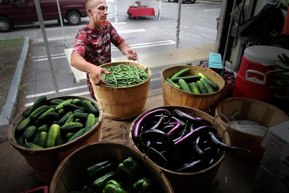 Kevin Bragg of Kimball Fruit Farm unloaded produce at the Brookline Farmers Market in Coolidge Corner.